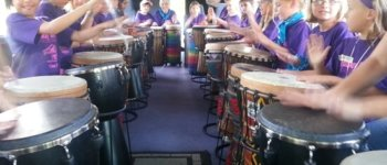 Kids drumming on the DrumBus.